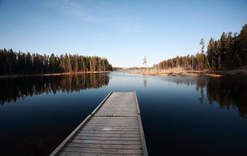 Dock on Northern Manitoba lake stock image