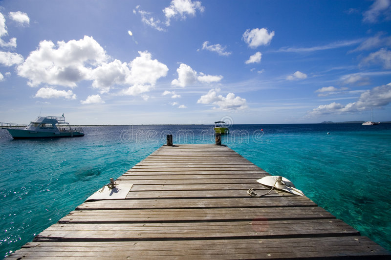 Dock and ocean, Bonaire royalty free stock image