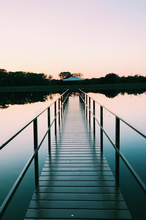 Dock perspective. Beautiful dock perspective with sunset stock photo