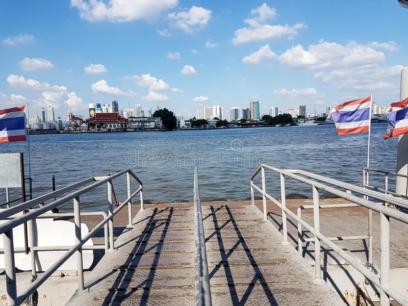 Dock / port boat into river with city view and blue sky landscape. Dock / port boat stock photos