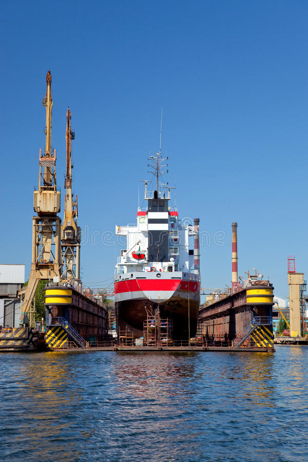 On the dock at the shipyard. A large cargo ship is being renovated in shipyard Gdansk, Poland stock photo