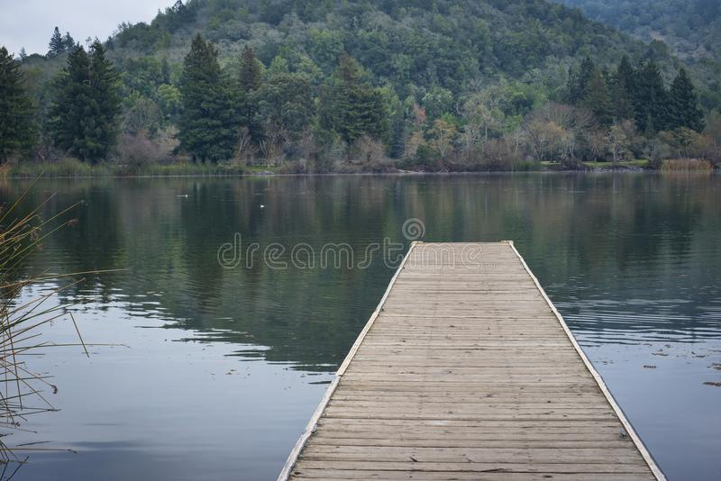 Dock on a small lake royalty free stock images