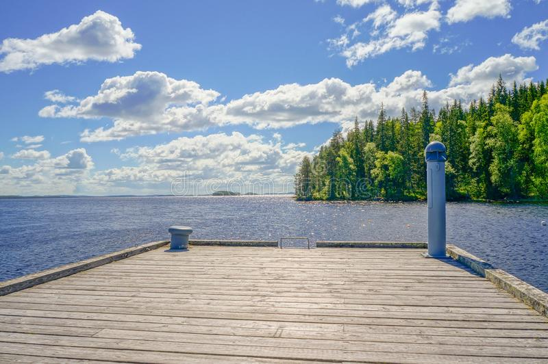 Dock on a Sunny Day at Lake Shore, Summer Landscape stock image