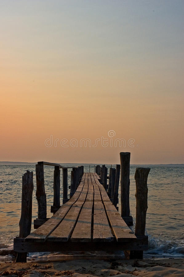 Dock at Sunset. Looking off into the distance of the Elizabeth Islands, wondering what lies beyond royalty free stock image