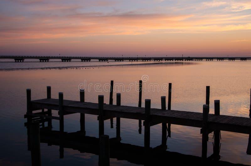 Dock at sunset stock photos