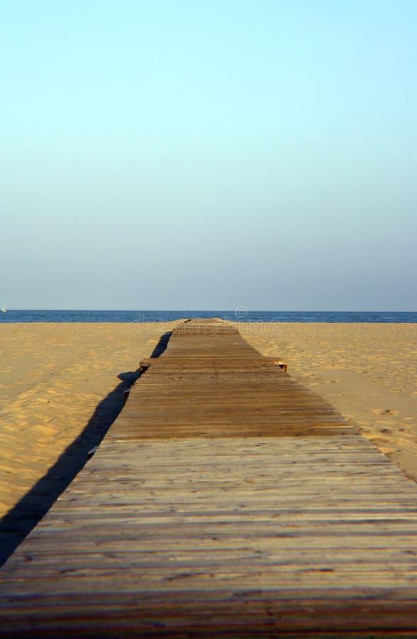 Dock to beach stock photos