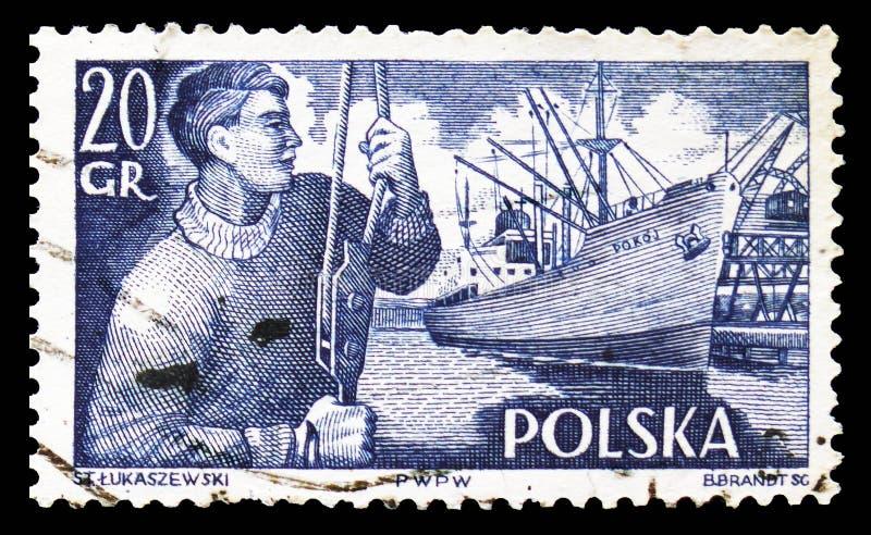 Dock worker and S.S. Pokoj freighter, Polish Merchant Navy serie, circa 1956 stock photo