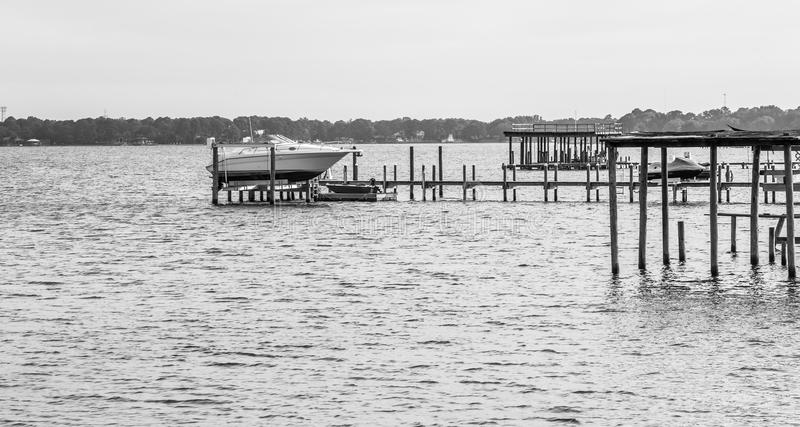 Docked Boat on Choctawhatchee Bay. In Ft. Walton Beach, Florida in the wake of Hurricane Irma. Image in black and white taken 06 September 2017 stock image