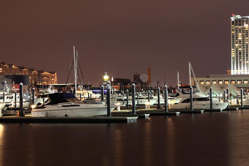 Docked Boats in Baltimore Inner Harbor. Image of the boats dock in the Baltimore Inner Harbor at night royalty free stock image