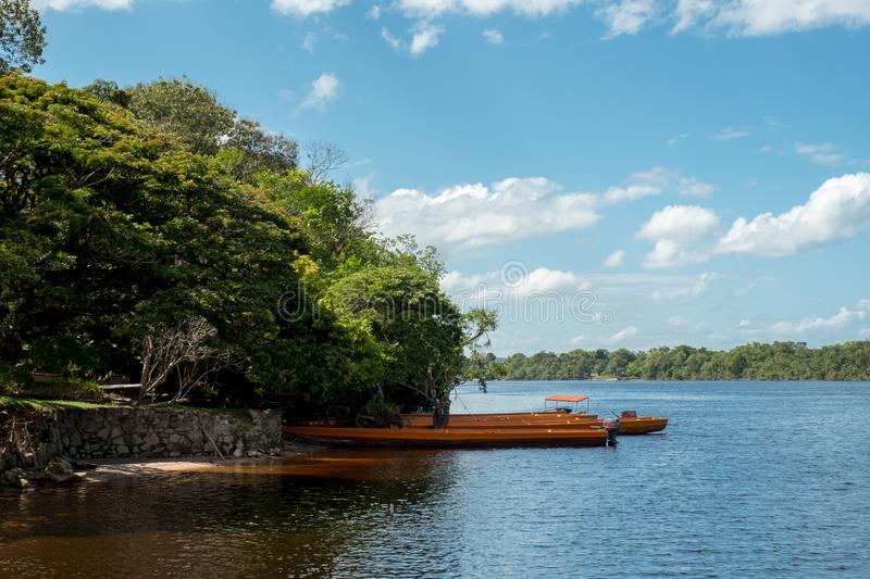 Docked Boats at a campsite in Ucaima, Venezuela. Boats are docked in the Carrao River, at a campsite in Canaima National Park, Venezuela royalty free stock photography