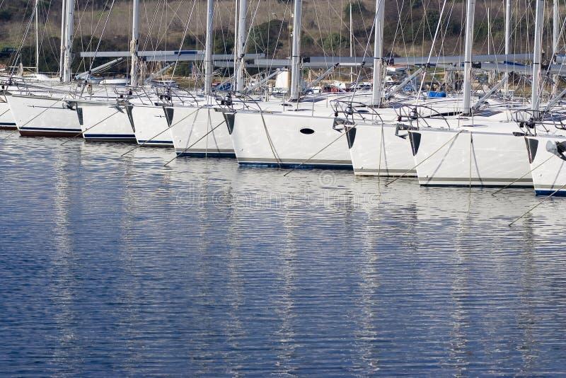 Docked sailboats stock image