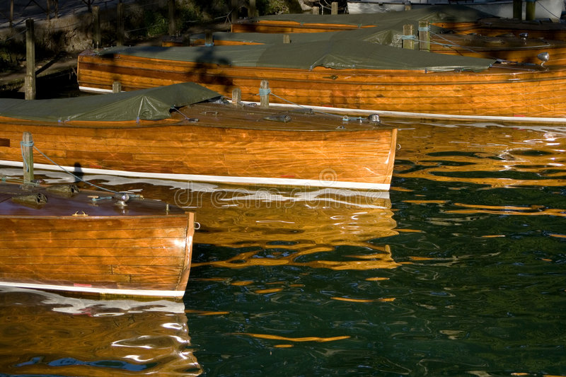 Docked wooden boats stock image