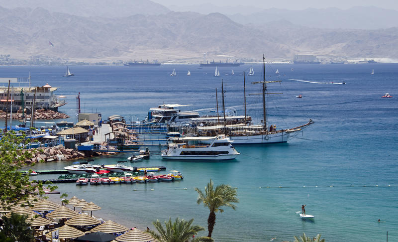 Docked yachts and boats in marina of Eilat, Israel. The shot was taken from the northern beach of Eilat city - a famous resort and recreation center of Israel royalty free stock photography