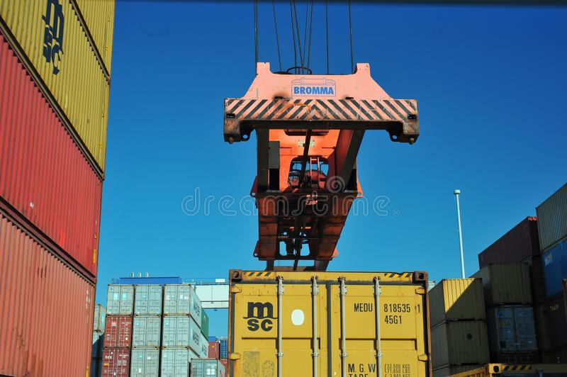 Dock crane elevate a msc container. Docks operations on portuguese harbor matosinhos,who has moved 600000 teu last year royalty free stock images