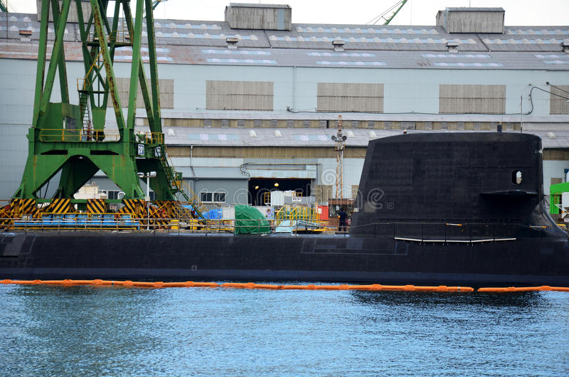 Docks of submarine and shipbuilding or shipyard in the sea at Ko. Be bay on July 9, 2015 in Kobe, Japan royalty free stock photo
