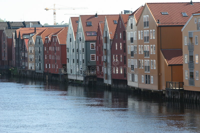 The docks of Trondheim. The old wooden seahouses along the Nidelven River in Trondheim, Norway stock images