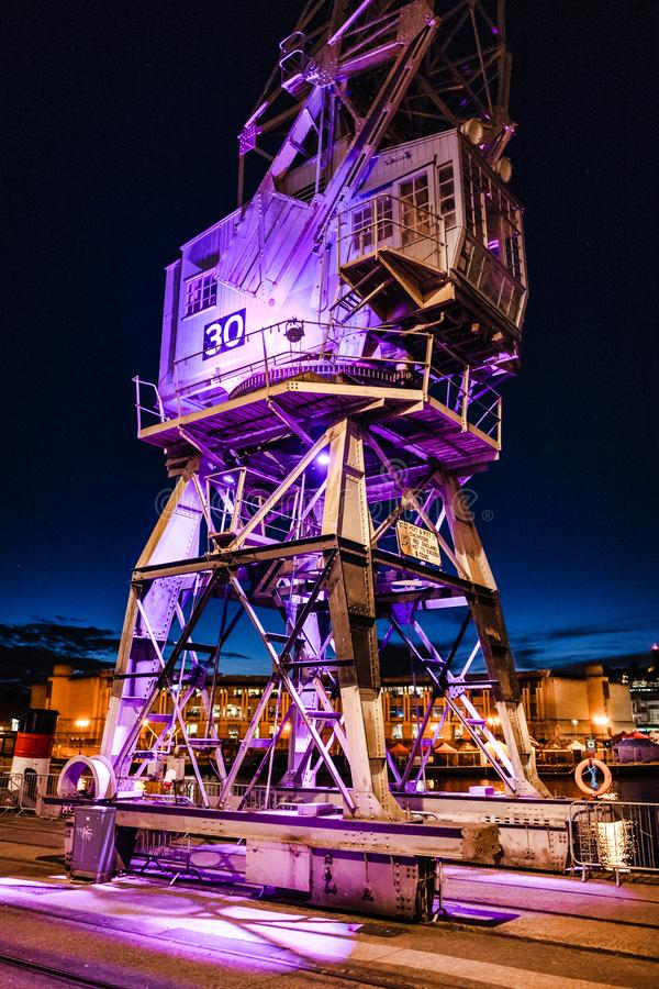 Dockside Crane at night. A dockside crane lit up at night in Bristol, England stock photography