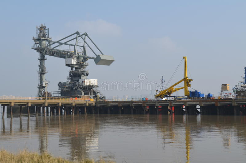 Dockside cranes along Tilbury in Essex. Heavy dockside equipment along the River Thames at Tilbury, Essex royalty free stock photos