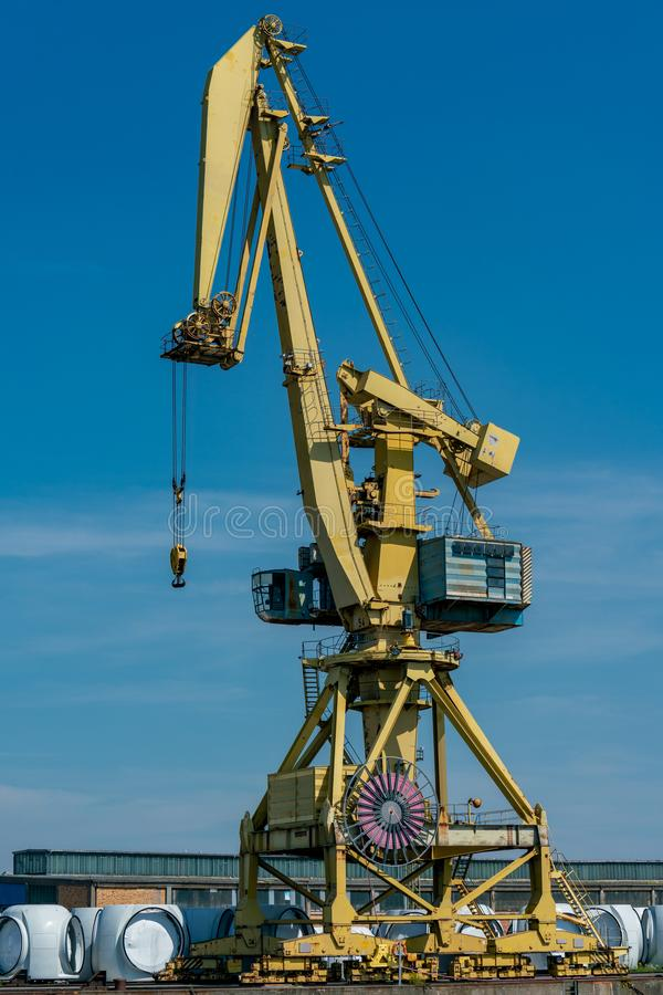 Yellow dockside crane at the industrial harbour in Rostock. Details of a yellow dockside crane at the europort harbour in Rostock stock photos
