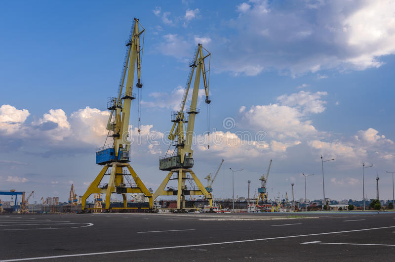 Dockside cranes on rail. On Constanta port. Constanta is the largest port on the Black Sea and the 18th largest in Europe royalty free stock photo