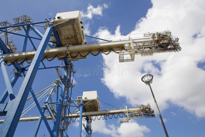 Dockside Cranes Used For Unloading Container Ships. Low angle view of dockside cranes used for unloading container ships at Limassol Cyprus royalty free stock images