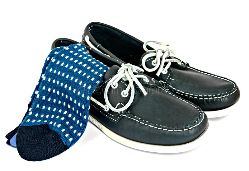Docksides deck shoes with hand-linked toes socks stock photos