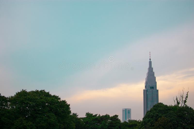 Docomo Tower in Shinjuku, Japan. Shinjuku is located in the central of Tokyo and usually there are many people aroundIn summer tim. E, international stock photography