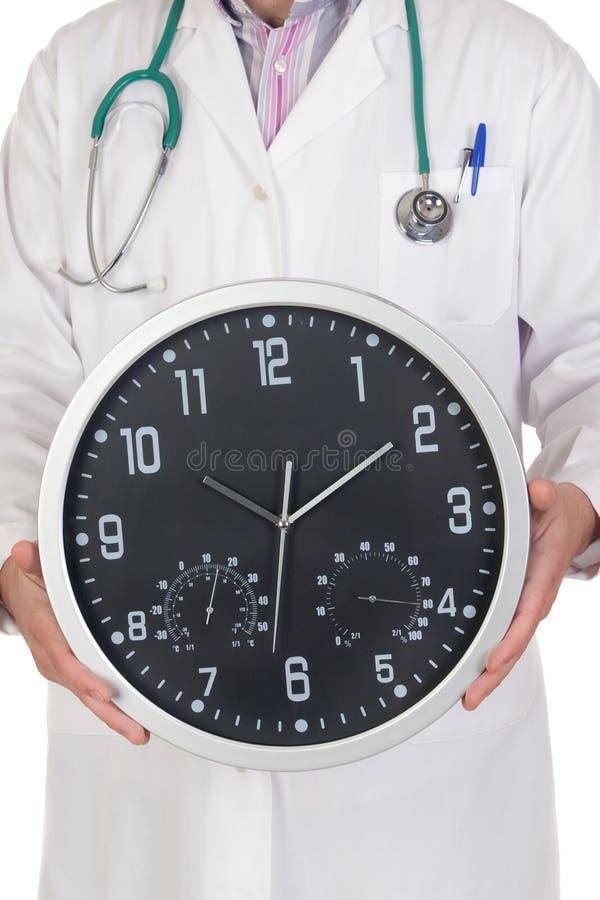 Docteur avec la grande horloge photographie stock