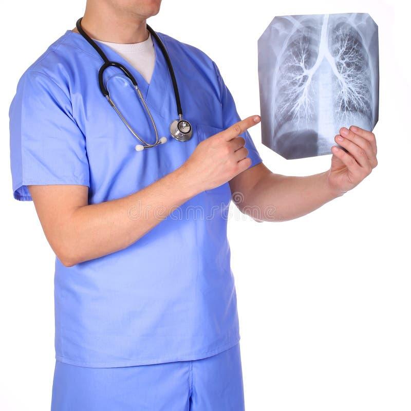 Docteur avec les photos de examen de rayon X de stéthoscope d'isolement photographie stock