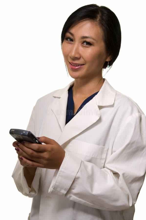 Docteur avec un pagineur photo stock