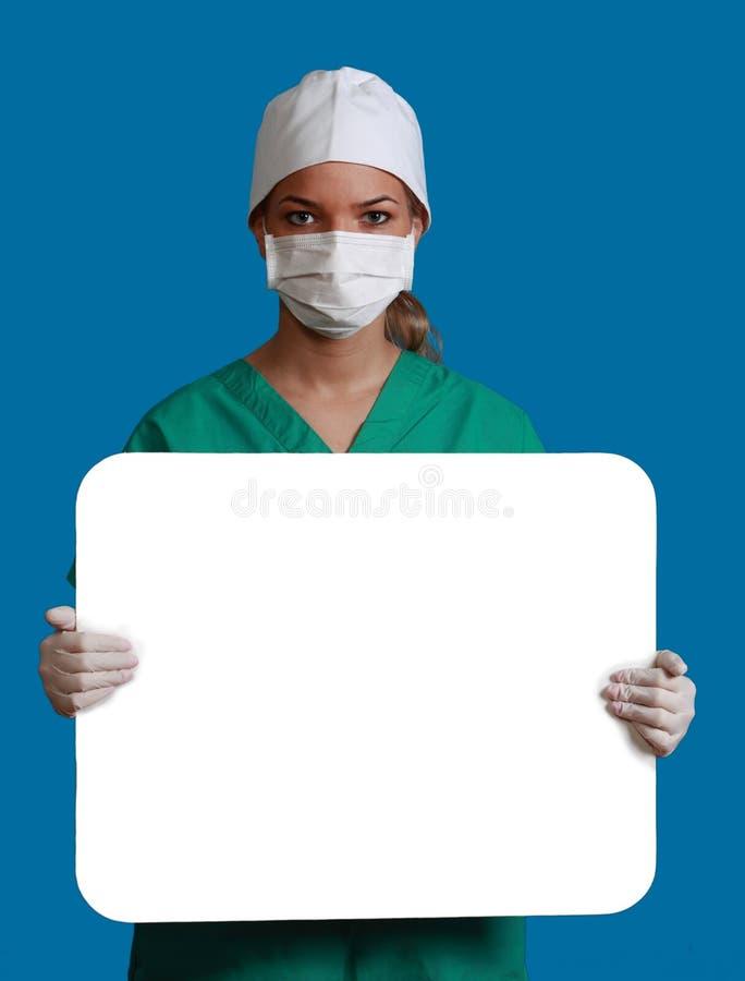 Docteur avec un panneau blanc image libre de droits