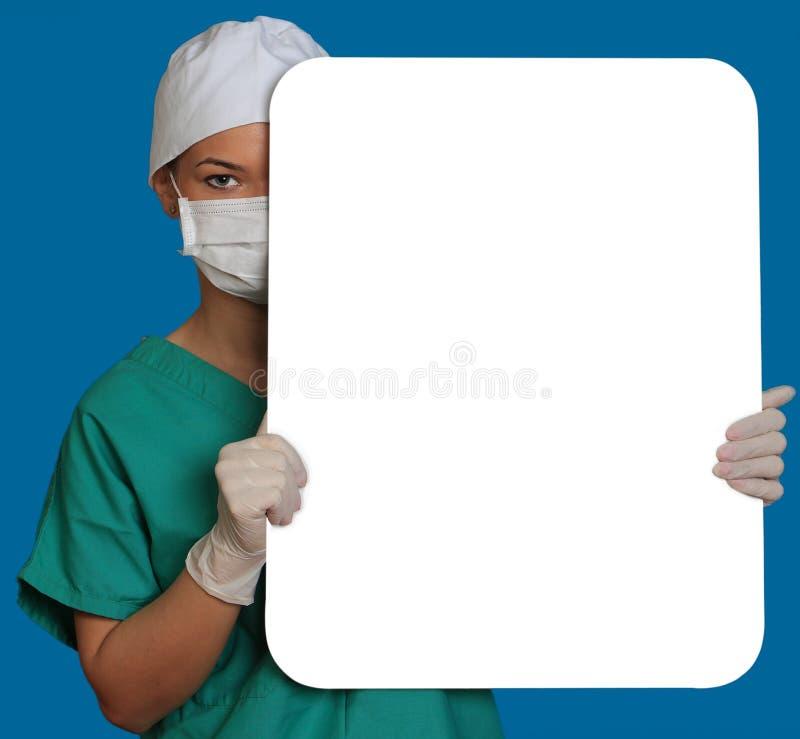 Docteur avec un panneau blanc photos libres de droits