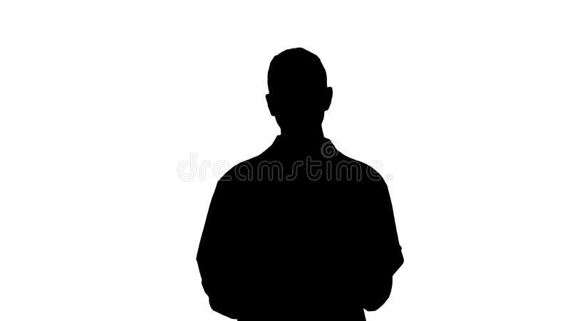 Docteur de femme de silhouette expliquant et parlant à la caméra tout en marchant image libre de droits