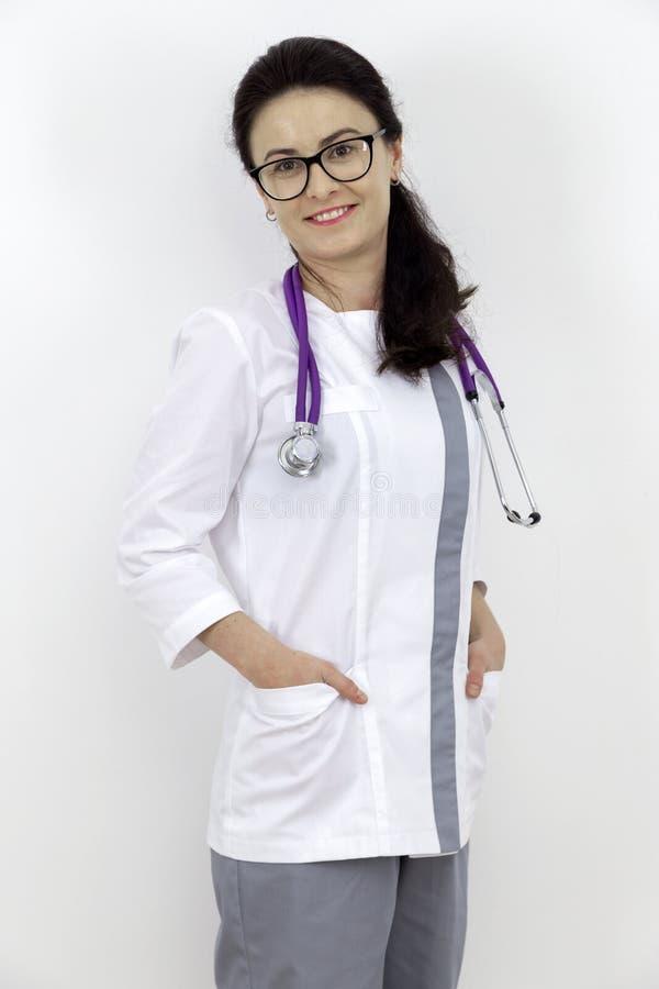 Docteur de jeune fille avec le stéthoscope image stock