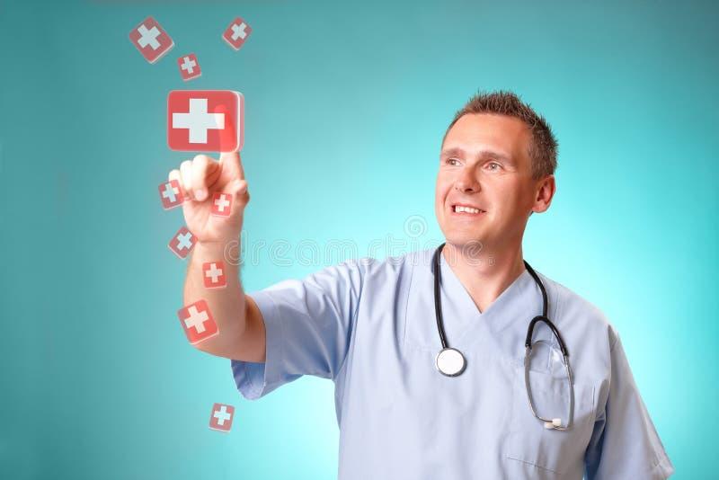 Docteur de médecine avec les tabletes olographes images libres de droits