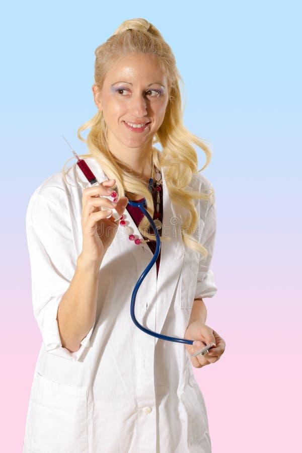 Docteur de sourire avec la seringue images libres de droits