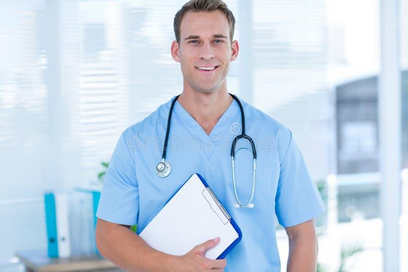Download Docteur De Sourire Regardant L'appareil-photo Photo stock - Image du fonctionnement, sourire: 56483858