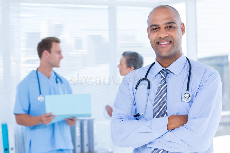 Download Docteur De Sourire Regardant L'appareil-photo Image stock - Image du people, heureux: 56484137