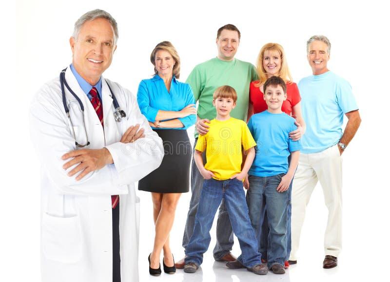 Docteur et famille images stock
