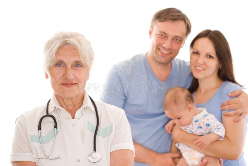 Docteur et famille photographie stock