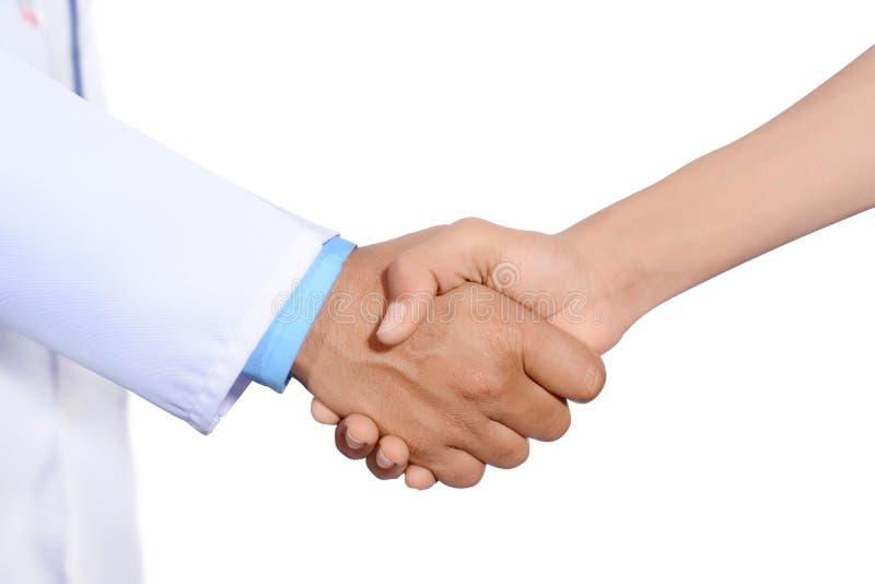 Docteur et main de secousse patiente images libres de droits