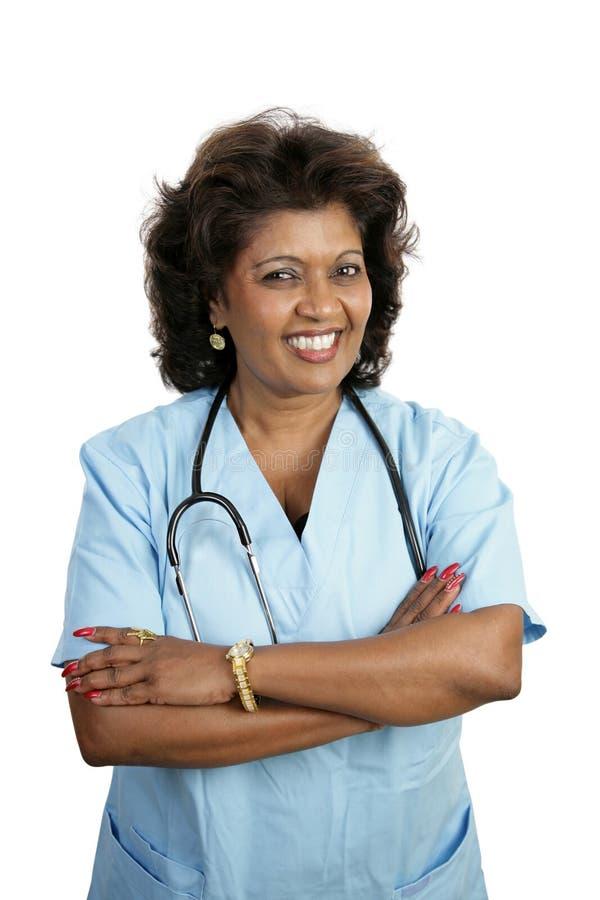 Docteur féminin attirant photos stock