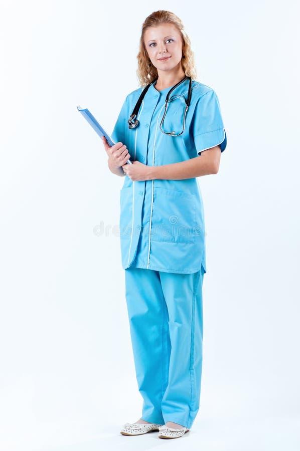 Docteur féminin sur le blanc images stock