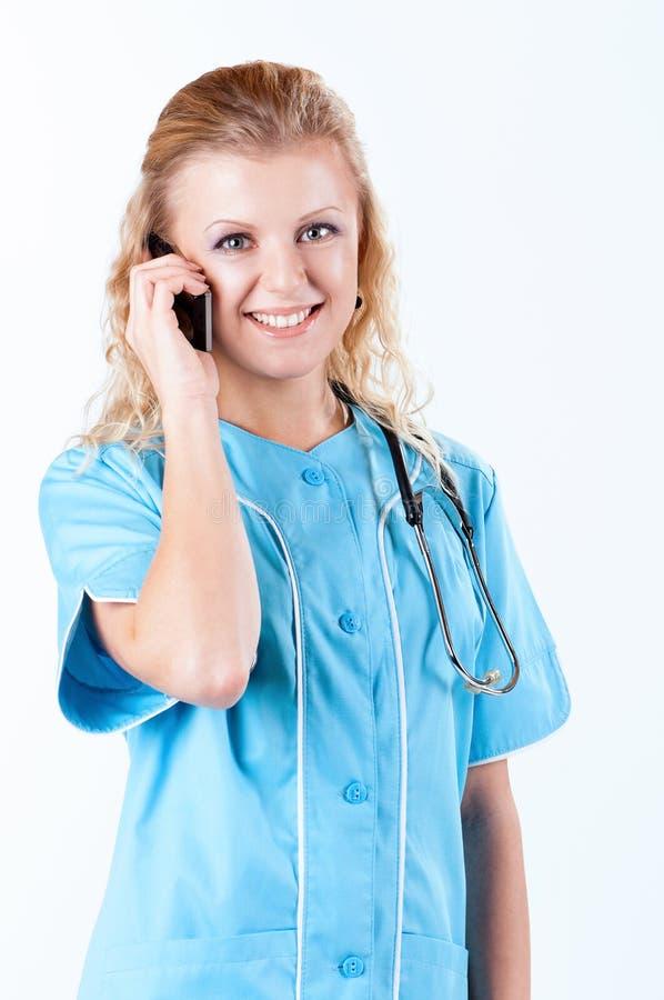 Docteur féminin sur le blanc photos stock