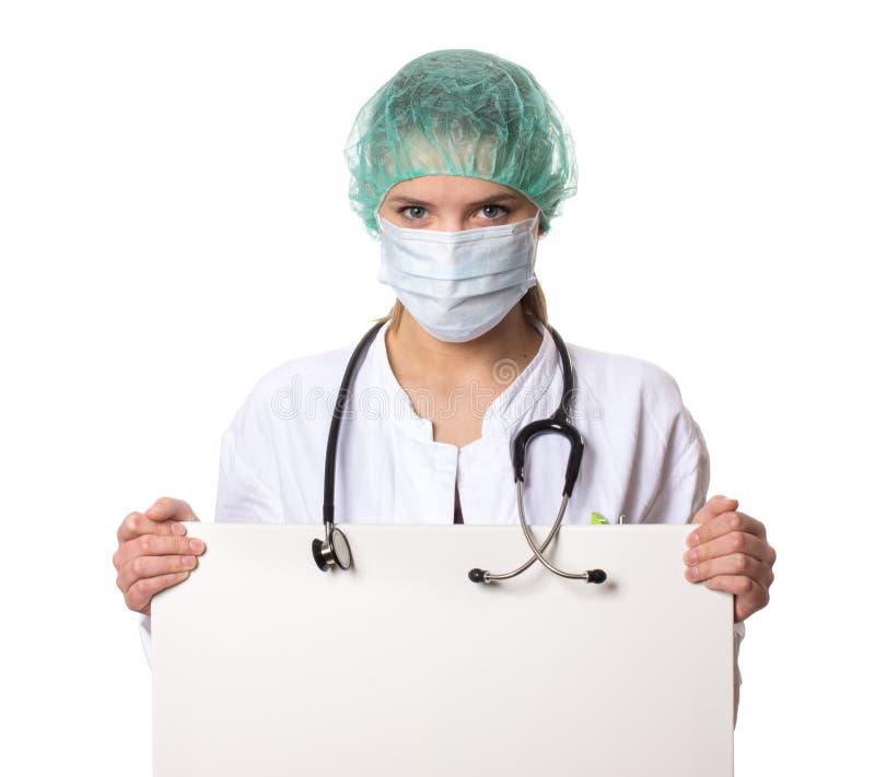 Docteur féminin tenant un signe image libre de droits
