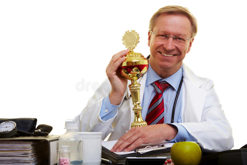 Docteur gagnant une récompense photographie stock