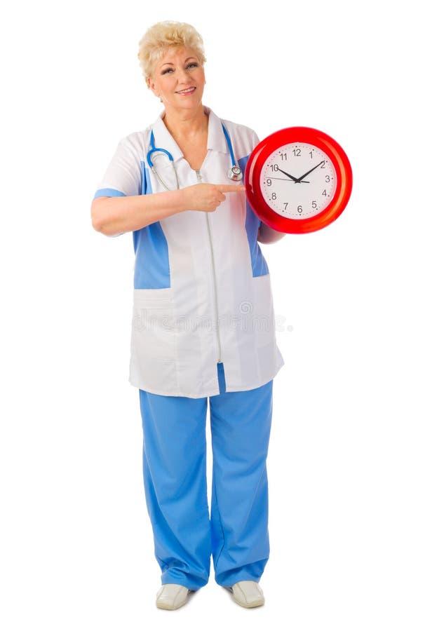 Docteur mûr avec l'horloge photographie stock libre de droits