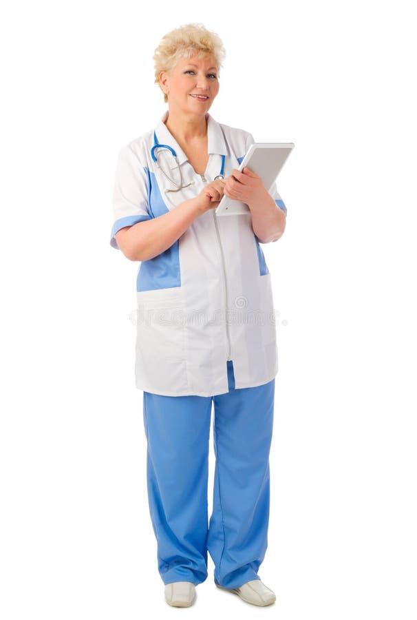 Docteur mûr avec la tablette images libres de droits
