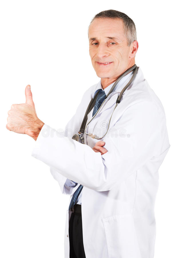 Docteur masculin mûr avec le pouce  images libres de droits