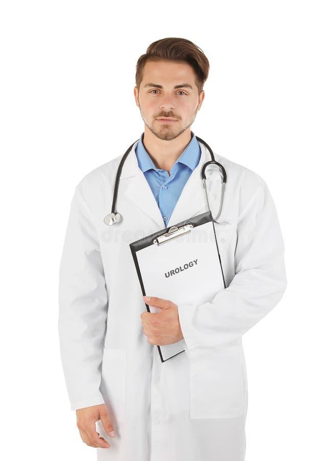 Docteur masculin tenant le presse-papiers avec le mot UROLOGIE images libres de droits